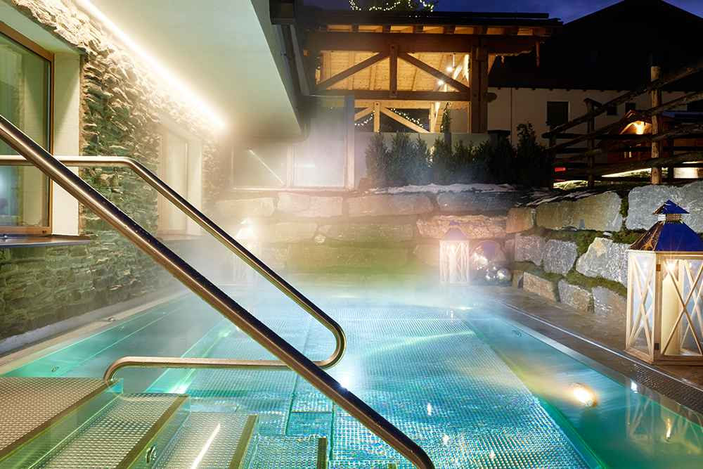 Outdoor pool in the Small Luxury Hotel of the World GROSSARLER HOF in the Grossarl Valley SalzburgerLand
