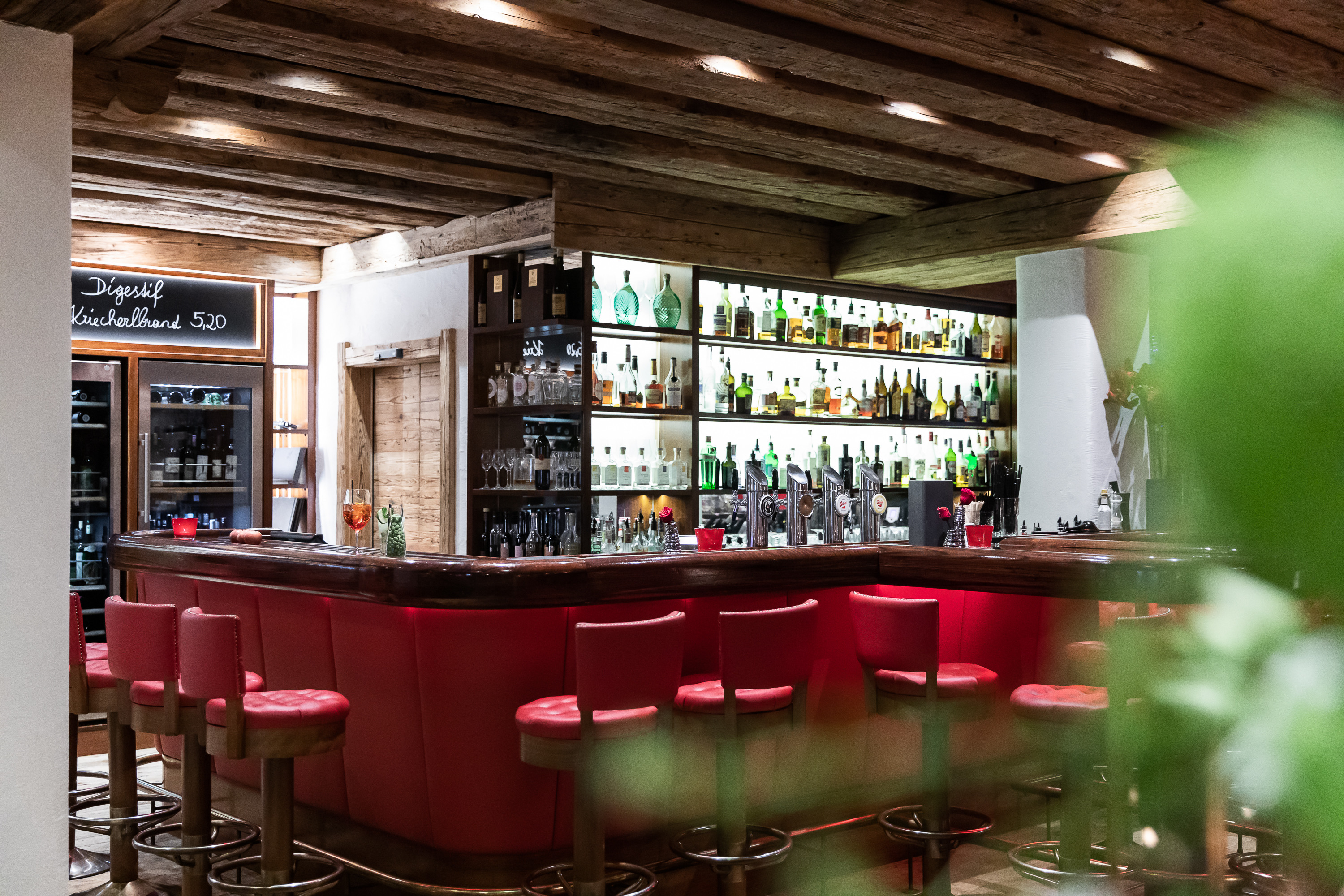 Lobby with fireplace & American Bar at the GROSSARLER HOF